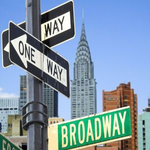 a road sign of broadway